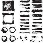 Hand drawn grunge brush strokes and paint splatters set isolated on white.