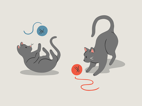 Hand-drawn vector illustration of cute playful cats with yarn