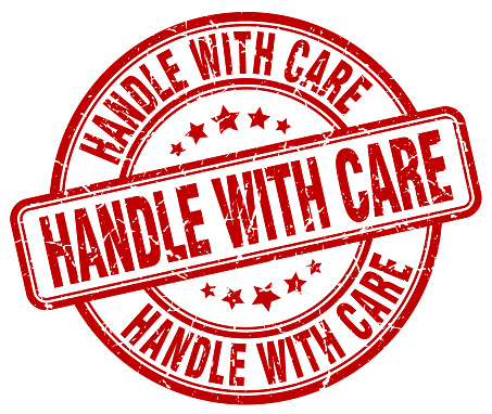 handle with care red grunge round vintage rubber stamp