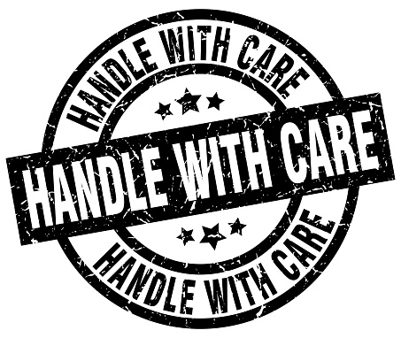 handle with care round grunge black stamp