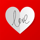 Love vector ink lettering valentine concept on folded heart shaped sticker with shadow on red background.