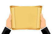 istock Hands are holding a blank scroll of paper. 1296969085