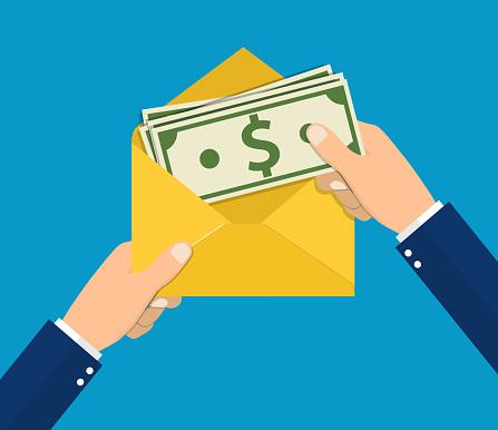 Hands businessman holding envelope with cash.