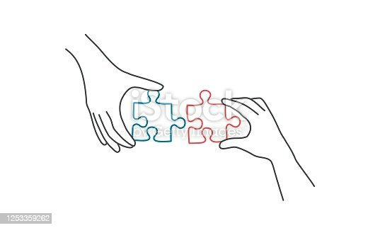 istock Hands connecting jigsaw puzzle. 1253359262