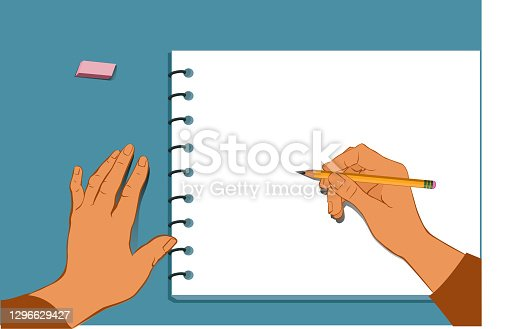 istock Hands draw on notepad 1296629427