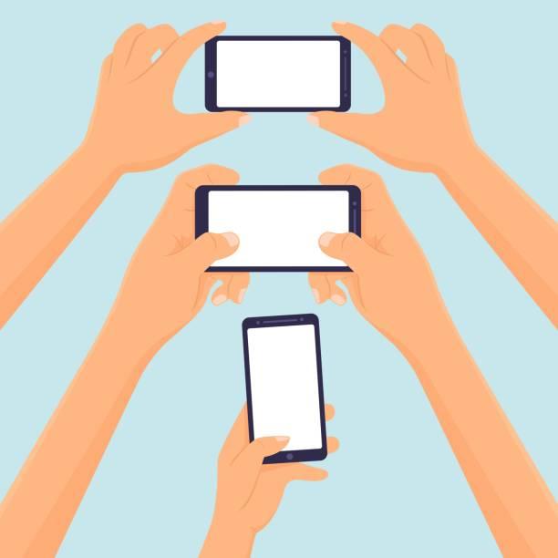 hände halten smartphone-vektor-illustration - selfie stock-grafiken, -clipart, -cartoons und -symbole