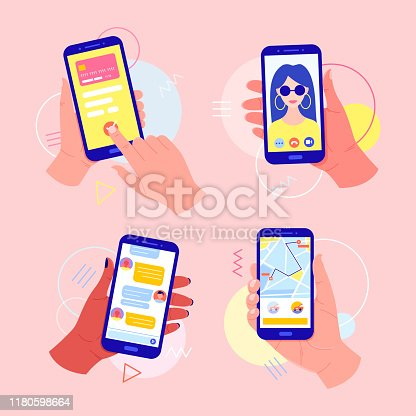 istock Hands holding a mobile phone with applications on the screen: online payment by card, video call, taxi call, chat in the messenger. 1180598664