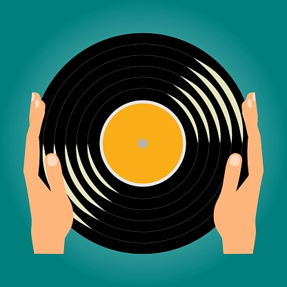 Hands holding a Vinyl music record
