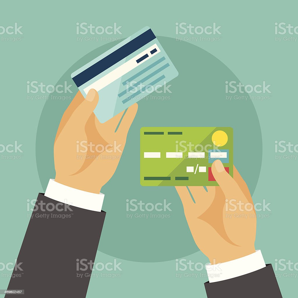 Hands holding bank cards in flat design style. vector art illustration