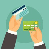 Hands holding bank cards in flat design style.