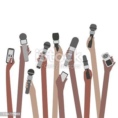 istock Hands Holding microphones during press conference or interview speech 1184722953