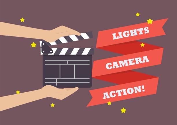 stockillustraties, clipart, cartoons en iconen met handen met film klepel bestuur - acteur
