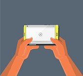 Hands holding smartphone. Video player on the screen. Cartoon style