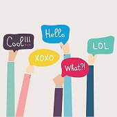 Hands Holding Speech Bubbles with Social Media Words. Vector ill