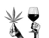 istock Hands holding wineglass and hemp leaves 1293849368