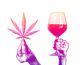 istock Hands holding wineglass and hemp leaves 1293849371