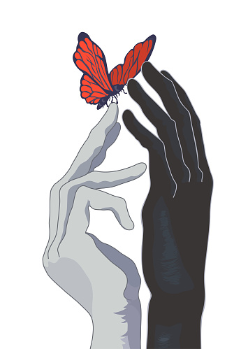 Hands of a harlequin with a butterfly on the tip of a finger