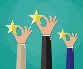 Hands of customers placing rating stars