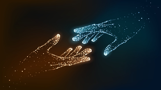 Hands of glowing blue particles