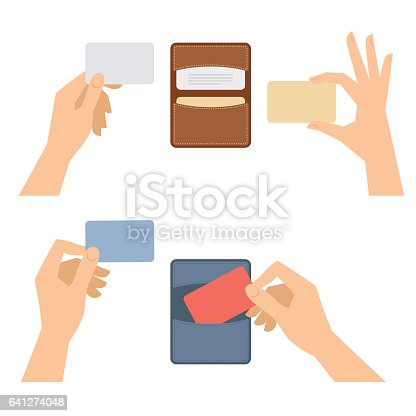 istock Hands takes out business card from holder, holds credit cards. 641274048