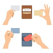 Hands takes out business card from holder, holds credit cards.