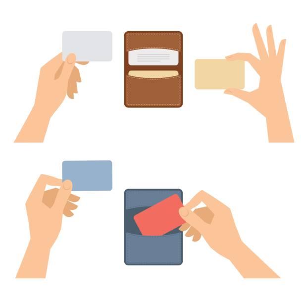 ręce wyjmuje wizytówkę od posiadacza, posiada karty kredytowe. - ręka człowieka stock illustrations