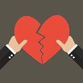 Hands tearing apart heart symbol. Love concept