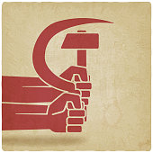 istock hands with hammer and sickle old background 515781470