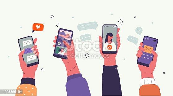 istock hands with smartphones 1223365194