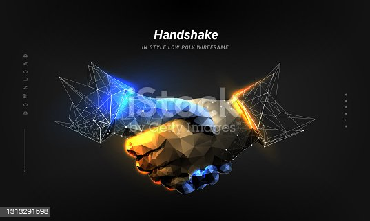 istock Handshake. Abstract image two hands handshake in the form of a starry sky and flaming steel. Isolated on dark background. Low poly wireframe. Particles are connected in a geometric silhouette 1313291598
