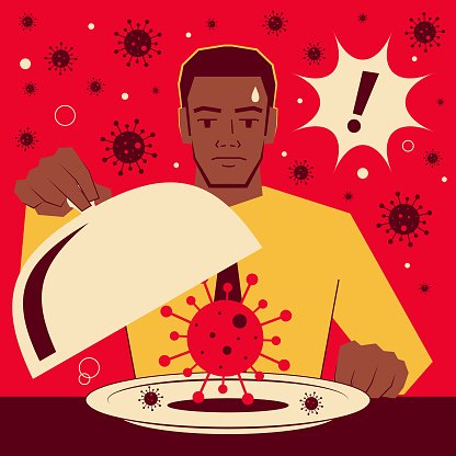 Handsome African-American ethnicity businessman taking the domed lid off a tray that has coronavirus (covid-19, bacterium, virus)