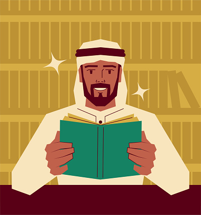 Handsome arabian businessman is reading a book in the library; Never stop learning; To invest in yourself; Knowledge is power