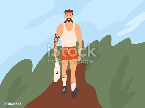 istock Handsome muscular man in red shorts with eco shopping bag in hand walking down street 1325034871