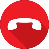 Vector illustration of a red phone icon in flat style hanging up.