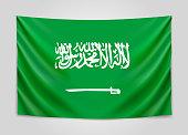 Hanging flag of Saudi Arabia. Kingdom of Saudi Arabia. National flag concept.