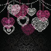 Five different highly ornate hearts on a black damask background. Room for your text.
