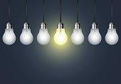 Hanging light bulb on a dark background