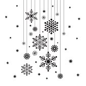 Hanging snowflakes baubles in silhouette on a white background.