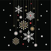 Hanging snowflakes baubles on a black background.