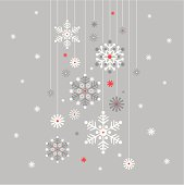 Hanging snowflakes baubles on a silver background.