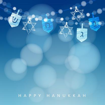 Hanukkah blue background. String of lights, dreidels and jewish stars.