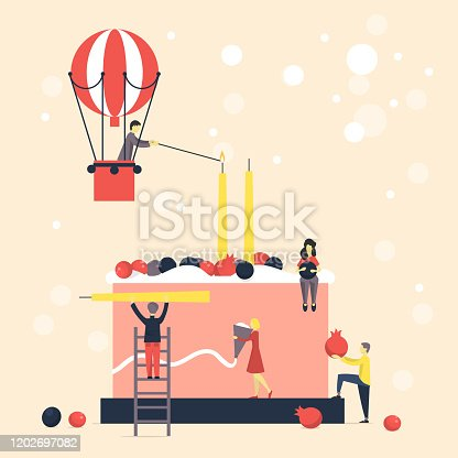istock Happy birthday card. People decorate birthday cake with candles. 1202697082