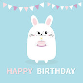 Happy Birthday. White bunny rabbit holding cake, candle. Paper flags hanging. Funny head face. Big eyes. Cute kawaii cartoon character. Baby greeting card template. Blue background. Flat design Vector