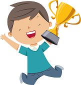 Happy boy holding gold trophy