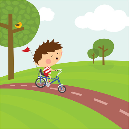 Happy boy riding a bicycle. Cycle path and nature