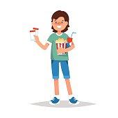 Happy boy with ticket and bucket of popcorn go to cinema