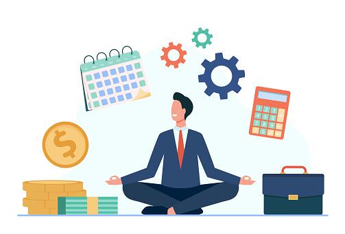 Happy businessman doing yoga at work