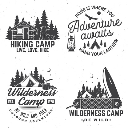 Happy camper. Vector. Concept for shirt or , print, stamp. Vintage design with lantern, pocket knife, campin tent, axe, camping tent, campfire, forest cabin and forest silhouette.