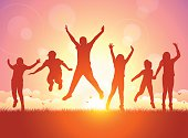 Vector illustration silhouettes of happy children jumping on sunset.