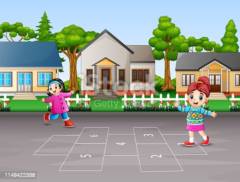 Happy children playing hopscotch in the yard